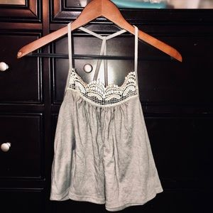 Grey blouse with lace detail.